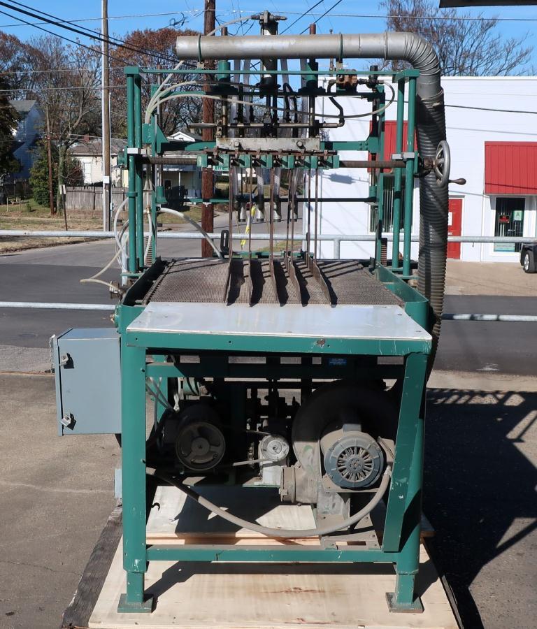 4 lane bottle cleaner/feeder, for unloading re-shipper cases of bottles into a bottling line1