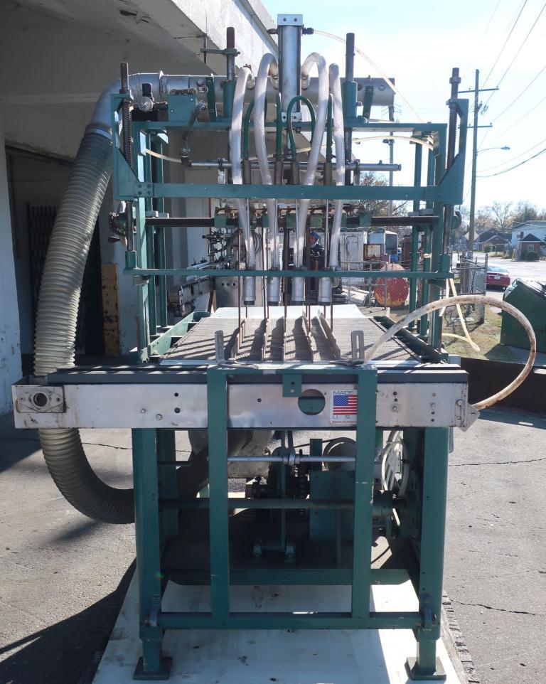 4 lane bottle cleaner/feeder, for unloading re-shipper cases of bottles into a bottling line4