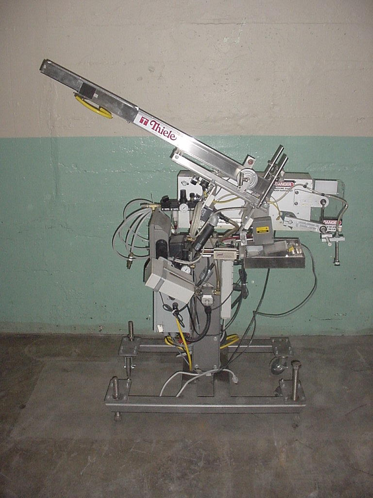 Labeler Thiele Engineering Co. reciprocating placer model S-106, up to 44 cpm2