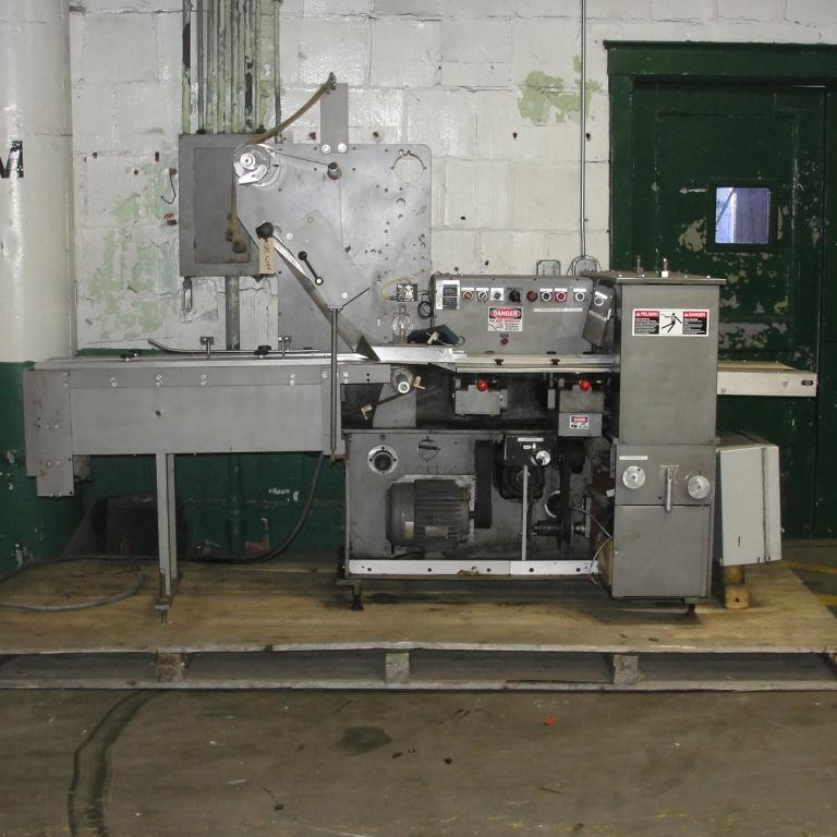 Wrapper Doboy horizontal flow wrapping machine model Super Mustang, speed 120 cpm