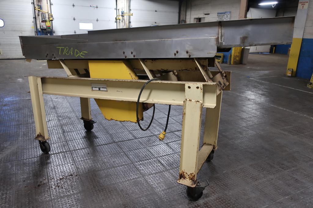 Feeder 24 w x 111 L and narrows to 12 1/2  Newcombe Enterprises vibratory feeder model Serial #581-014A1381, Stainless Steel1