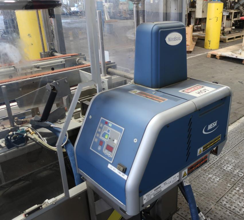 Case Packer Econocorp, Inc side-load case packer model Econocaser, up to 600 cartons per hour5