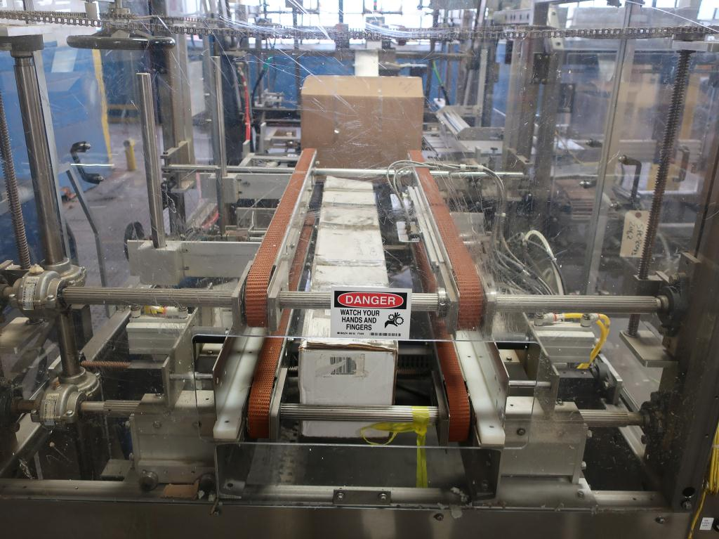 Case Packer Econocorp, Inc side-load case packer model Econocaser, up to 600 cartons per hour9