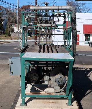 4 lane bottle cleaner/feeder, for unloading re-shipper cases of bottles into a bottling line