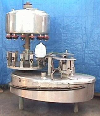 Filler 14 valve Cemac liquid gravity filler 6 centers, up to 35 cpm