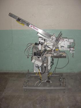 Labeler Thiele Engineering Co. reciprocating placer model S-106, up to 44 cpm