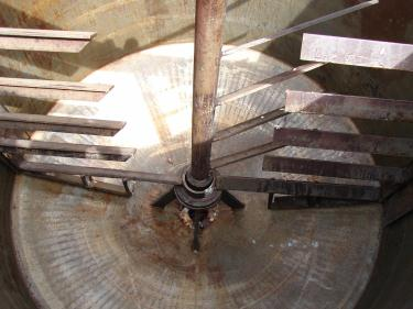 Tank 575 gallon vertical tank, CS, Low Pressure jacket, sweep agitator, conical Bottom