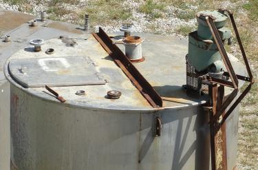 Tank 2200 gallon vertical tank, Stainless Steel, .5 Hp agitator, conical bottom