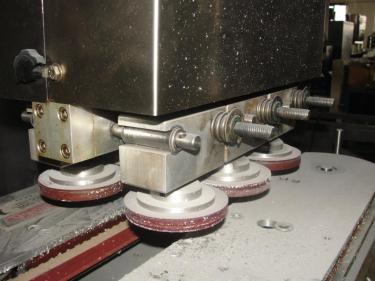 Capping Machine Ron Unger Engineering retorquer cap tightener