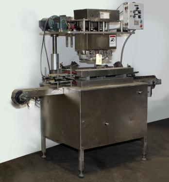 Capping Machine Ron Unger Engineering retorquer cap tightener model 3400