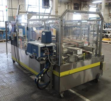 Case Packer Econocorp, Inc side-load case packer model Econocaser, up to 600 cartons per hour