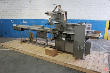 Wrapper Doboy horizontal flow wrapping machine model Super Mustang, 8.5 lug spacing