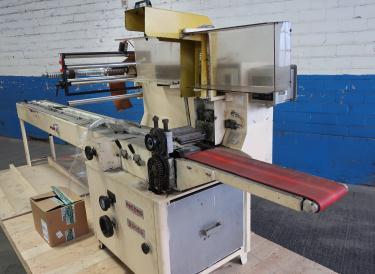 Wrapper Record horizontal flow wrapping machine model Panda, 7.5 lug spacing